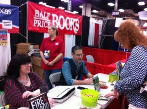 Victoria Scott and Greg Leitich Smith signing at the Texas Book Festivals booth.