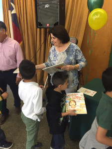 Diane Bertrand Gonzalez giving out books to happy kids!